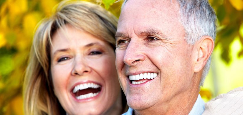 smiling-older-couple-implants